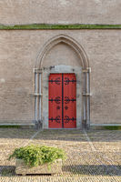 Medieval door in brick wall