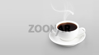 Cup of coffee on color background solid