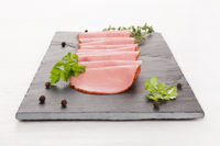 Delicious duck ham served with fresh herbs.