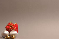 Silver vintage Christmas baubles on a grey background with space for your text or image