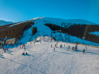 Skiers on the Winter Ski Slope on a Sunny Day. Aerial View