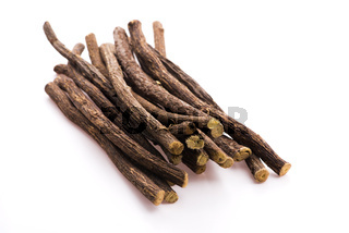 Licorice roots on white background