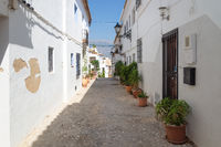 Narrow medieval street in the old town center of Altea, Costa Blanca, Spain