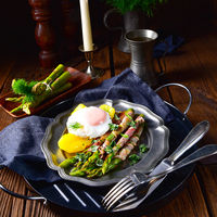 delicious green asparagus wrapped in bacon and egg