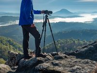 Outdoor photographer journalist hold dslr camera
