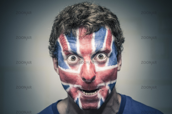 Scary man with British flag painted on face