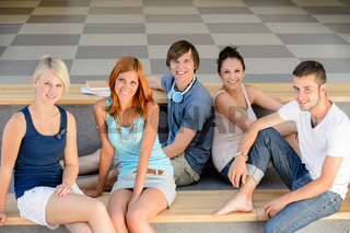 Group of college students sitting looking camera