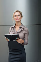 Beautiful business woman uses a digital tablet