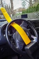 A car secured with a yellow steeringwheel lock