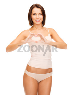 woman forming heart shape