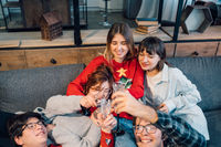 Group friends talking sitting in a couch in the living room
