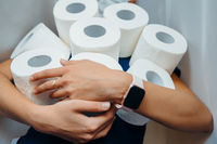 People are stocking up toilet paper for home quarantine from coronavirus.
