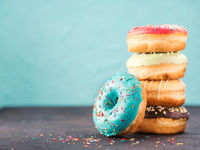 Stack of assorted donuts, copy space