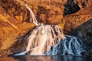 Little waterfall in the mountains, Iceland