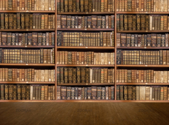 Defocused shelves of old antique books for background to video conference