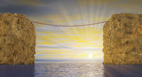Suspension bridge on sea sunset