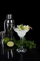 Tequila, Citrus liquor, lime juice - this is a Margarita cocktail. A  of lime with a sprig of mint d