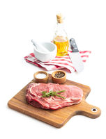 Sliced raw ribeye steak on cutting board