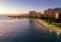 Aerial view of Waikiki beach towards Honolulu at sunset