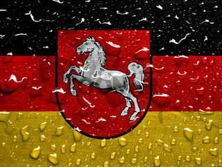 flag of Lower Saxony with rain drops