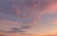 Beautiful multi colored sunset view. Full frame cloudy sky background.