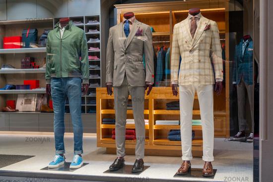 Male dummy in a shop window. Sale of men's clothing.