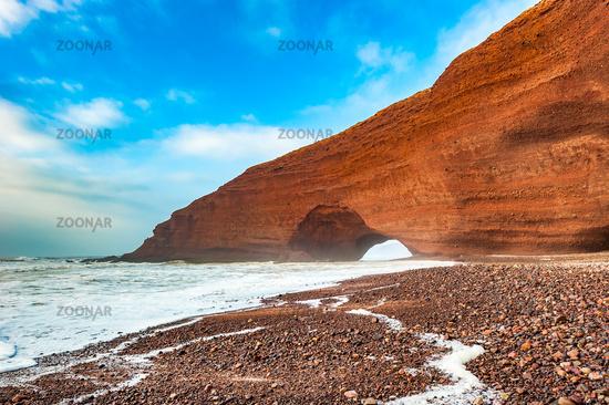 Red arches of Legzira beach, Morocco.