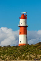 Red and white lighthouse on the isle of Borkum