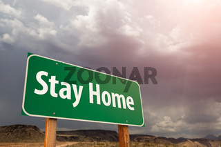 Stay Home Green Road Sign Against Ominous Stormy Cloudy Sky