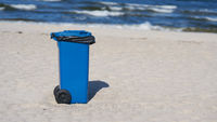 blue garbage can on the beach of Swinoujscie on the Polish Baltic Sea coast