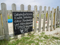 Humorous sign on the sandpit fence