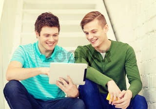 smiling male students with tablet pc computer