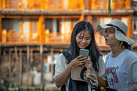 Young girls taking selfie photo in Fenghuang