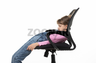 Girl funny lay down in an office chair