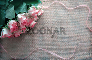 Valentine's day background with roses and loop isolated on brown Background.