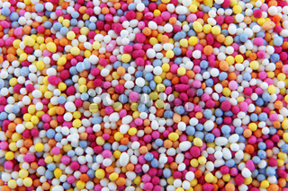 hundreds and thousands sprinkles tiny sugar beads for decorating cakes and desserts background texture