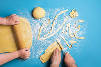 Couple making pasta by hand. Cooking together. Pasta tagliatelle