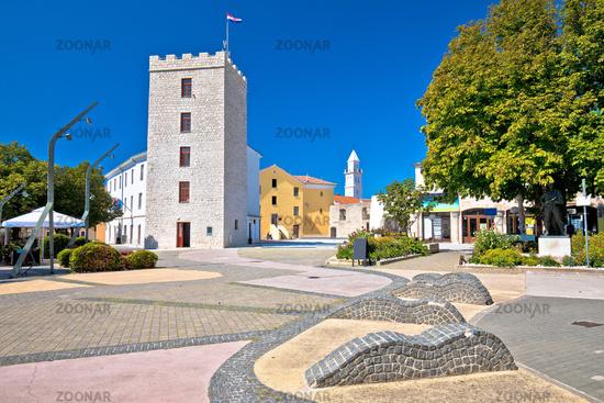 Town of Novi Vinodolski tower and old stone square view