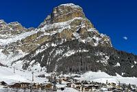 Peak Sassongher rising above the ski resport Corvara, Kurfar, Alta Badia, Dolomites, Italy