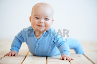 Happy baby with a beaming smile
