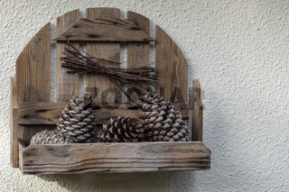 Wooden rack with pinecone