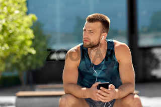 young athlete man with earphones and smartphone