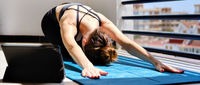 Woman perform yoga asana on terrace at home horizontal image