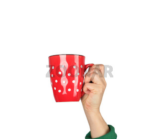 red ceramic cup in a female hand on a white background