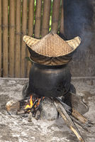 Traditional rice cooker over open fire, sticky rice cooking in  a bamboo basket, Luang Prabang, Laos