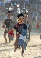 NAGALAND, INDIA, December 2013, Naga Warrior performing games during Hornbill Festival