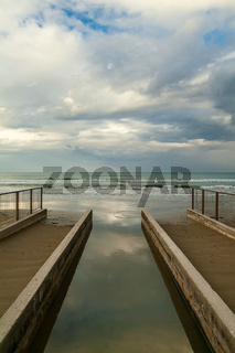 A little river pours its waters into the Adriatic sea