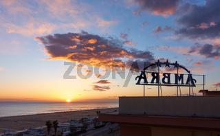 Sea and beach hotel sign at sunrise in Rimini