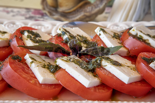 Traditional Italian Caprese salad on the plate. Close view.