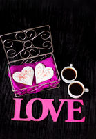 two cups of coffee, cookies in the form of heart inscription love